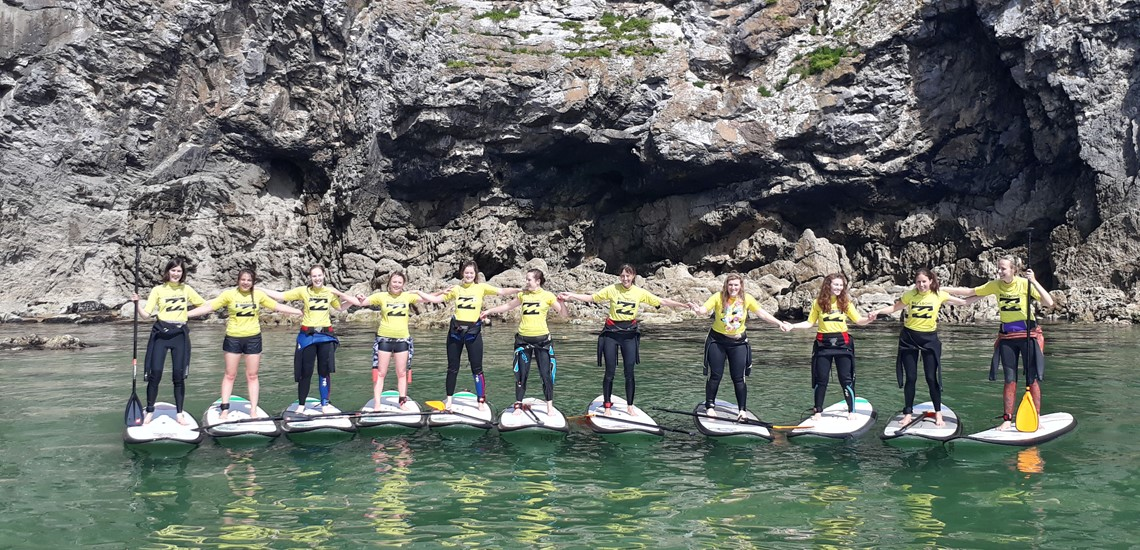 Paddle boarding and surfing at Broad Haven